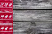Wooden background with a red frame of reindeer for christmas dec — Stock Photo