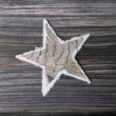 Natural wooden christmas in white and grey star for decoration. — Stock Photo