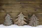Wooden handmade christmas trees - natural congratulatory card. — Stock Photo