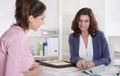 Professional business meeting under two woman: client and advise — Stock Photo