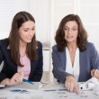 Two business woman analyzing balance sheet. — Stock Photo