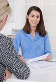 Appointment at a specialist for finance: female customer and adv — Stok fotoğraf