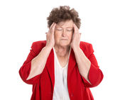 Isolated older woman with headache, migraine or forgetfulness. — Stock Photo