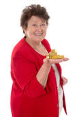 Isolated senior woman with gold bullion: concept for pension and — Stock Photo