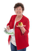 Isolated senior woman with money and gold: concept for pension a — Stock Photo