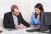 Business people - man and woman in a meeting - talking about fin — Stock Photo