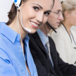 Smiling woman on the phone in a call center wearing blue blouse. — Stock Photo #49921933