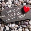Thank you greeting card with a red heart and text on wooden back — Stock Photo #49989113