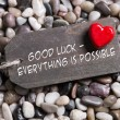 ������, ������: Good luck and everything is possible: greeting card with red hea