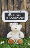 Funny greeting card with teddy bear and a wooden white sign with — Stock Photo