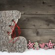 Wooden christmas background in red and grey with santa boot. — Stock Photo #50137493
