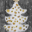 White christmas tree of snow decorated with golden miniatures. — Stock Photo #50138735