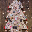 Handmade carved christmas tree decorated with gingerbread, stars — Stock Photo #50138761