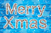 Merry Xmas wishes on blue wooden background and collage. — Stockfoto