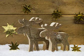 Two wooden handmade reindeer for christmas decoration with natur — Stock fotografie