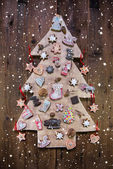 Handmade carved christmas tree decorated with gingerbread, stars — Stock Photo