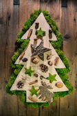 Christmas tree decorated with natural material from the forest. — Stock Photo