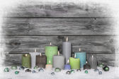 Christmas congratulatory card with many candles on wooden grey s — Stock Photo