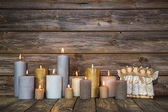 Christmas greeting card with candles and angels on wooden backgr — Stock Photo