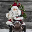 Old christmas decoration: santa claus and an old tin toy car wit — Stock Photo #50140045