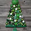 Green christmas decoration with wood: tree of balls on grey back — Stock Photo #50142111