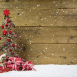 Christmas tree with red presents and snow on wooden snowy backgr — Stock Photo #50142355