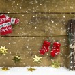 Wintry christmas decoration with ski and winter clothes on woode — Stock Photo #50142487