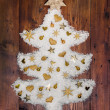 Christmas decoration: white tree of snow decorated with golden m — Stock Photo #50143437