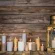 Wooden background in with many burning candles and a old rustic — Stock Photo #50143971