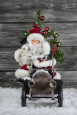 Old christmas decoration: santa claus and an old tin toy car wit — Zdjęcie stockowe