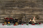 Vintage: old children toys for a christmas decoration - car, hor — Stock Photo
