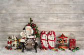 Funny christmas greeting card with santa and old children toys o — Stock Photo