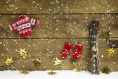 Wintry christmas decoration with ski and winter clothes on woode — Stock Photo