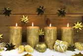 Four golden burning christmas candles for advent decoration. — Stock Photo