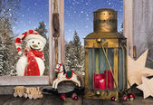 Christmas window decoration with old toys and a lantern with a r — Stock Photo