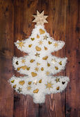 Christmas decoration: white tree of snow decorated with golden m — Stock Photo