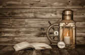Old wooden vintage background with book, lantern and nautical de — Stock Photo