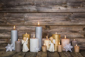 Christmas decoration with candles and angels on wooden backgroun — Stock Photo