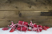 Red checked christmas presents on wooden country style backgroun — Stock Photo