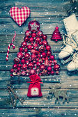 Christmas decoraion in red and white on wood in rustic vintage s — Foto de Stock