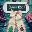Merry Christmas greeting card with french text on wooden backgro — Stock Photo #50684771