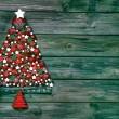 Christmas decoration in red and green: tree of balls on wooden b — Stock Photo #50776123