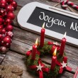French christmas card with four red burning candles in red. — Stock Photo #50775139