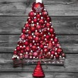 Red christmas tree with balls on old wooden shabby background. — Stock Photo #50776109