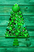 Christmas decoration in green: tree of different balls on wood. — ストック写真