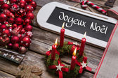 French christmas card with four red burning candles in red. — Stock Photo