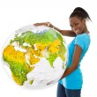 Isolated colored young woman holding a globe in her hands. — Stock Photo #50903829