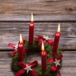 Four red burning advent candles on wooden background for christm — Stock Photo #50917391