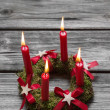 Greeting card: Four red burning advent candles on wooden grey ba — Stock Photo #50934903