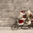 Two santa claus in hurry for buying christmas presents decorated — Stock Photo #50933931